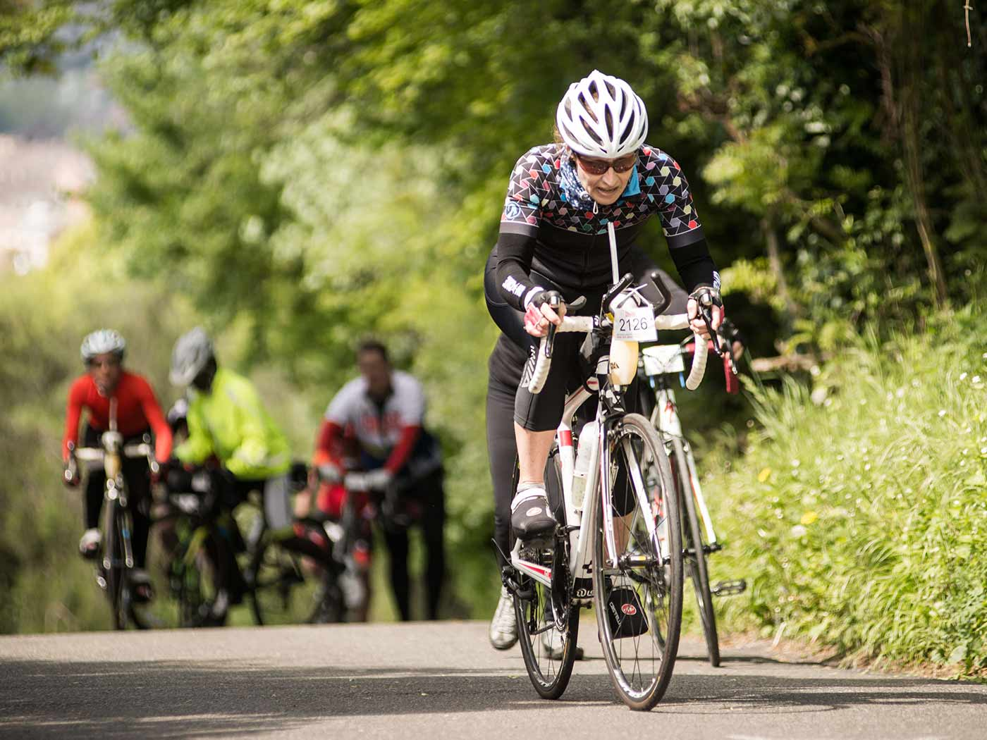 Cyclist climbing Kop Hill