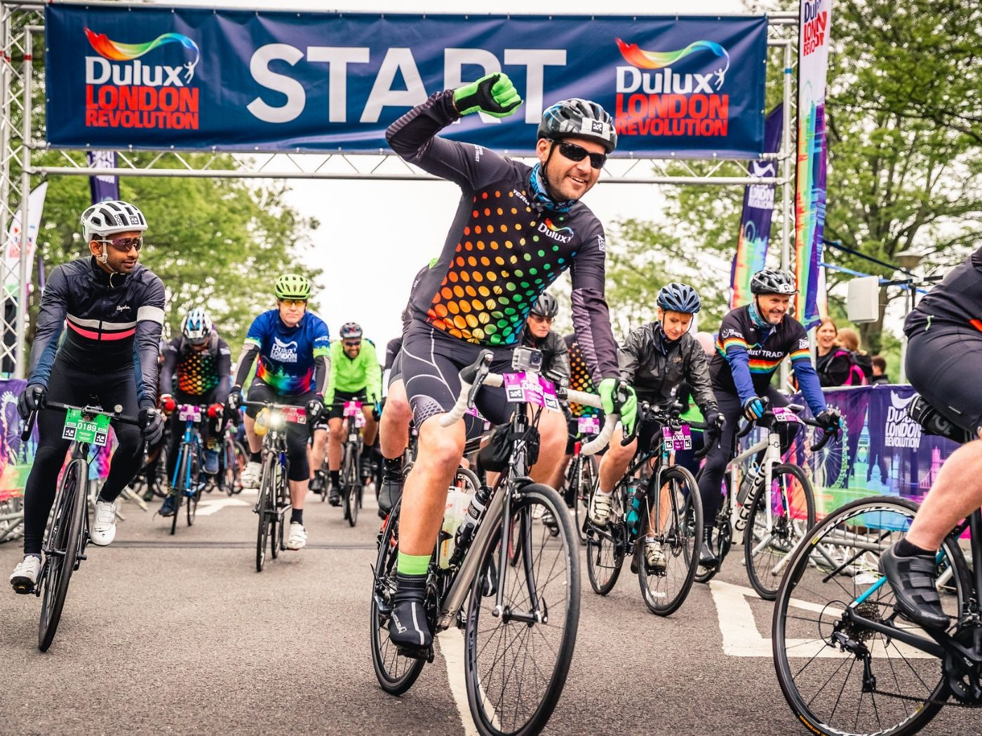 Cyclists crossing the start line at Dulux London Revolution