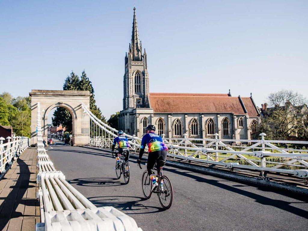 Riders crossing bridge